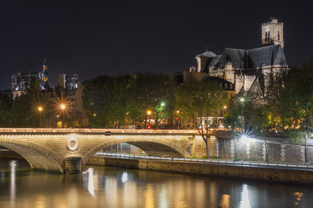 Pont Louis Philippe and Eglise Saint-Gervais at night. Paris. France