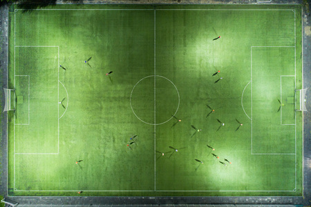 Stadium at night. Night football match. Two teams play football under the spotlights. Night workout. Preparation for the match.  Aerial shot with a drone from a altitude Stok Fotoğraf