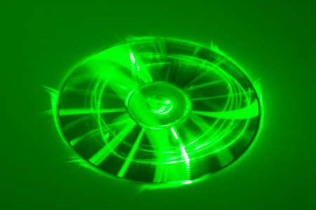 Compact disk under green laser beam Archivio Fotografico