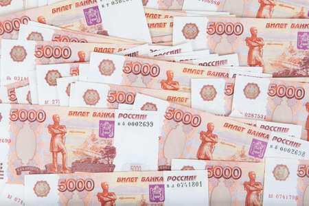 A bundle of banknotes for five thousand rubles. Close-up