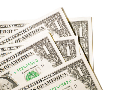 emolument: A few US banknotes on a white background