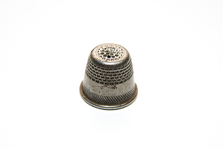 machinist: Vintage Iron thimble for hand embroidery on a white background