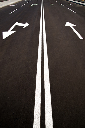 suffusion: Road markings in the form of arrows on the asphalt road in the city Stock Photo