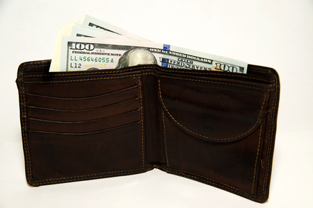 batch of dollars: Old leather wallet with banknotes of US dollars inside