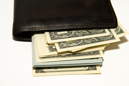billfold: Old leather wallet with banknotes of US dollars inside