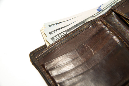 obtaining: Old leather wallet with banknotes of US dollars inside