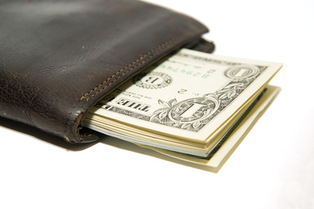 notecase: Old leather wallet with banknotes of US dollars inside