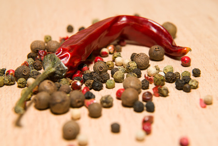 piquancy: Chili pepper and mix the grains are on a wooden surface