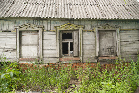 showwindow: Three windows of the old wooden house Stock Photo