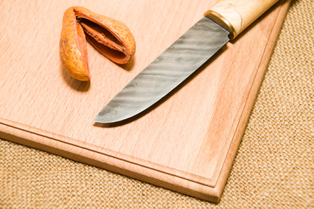 keen: Honed is a hunting knife on a wooden surface
