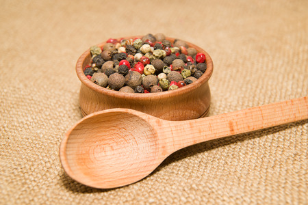 piquancy: A mixture of grains of pepper and spoon on old cloth Stock Photo
