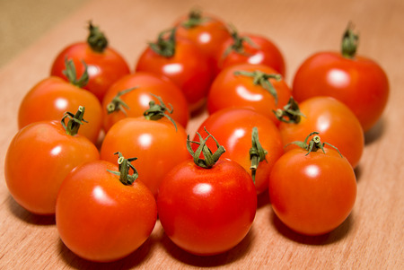 foetus: Ripe red tomatoes on a wooden surface