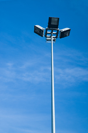 irradiation: Mast lighting the city streets on a background of blue sky Stock Photo