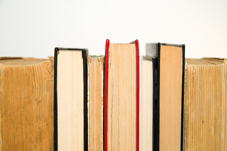 next to each other: Several books are next to each other
