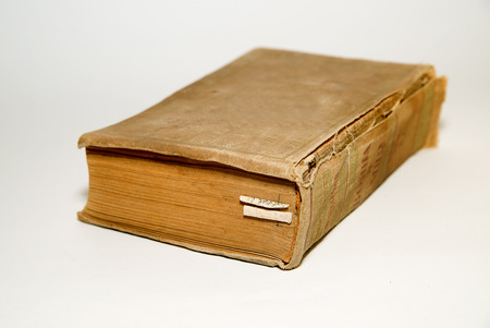 dissertation: One old big book on a white background Stock Photo