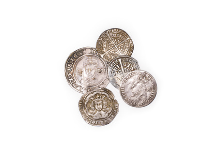 gelt: A lot of old silver coins with portraits of kings on a white background Stock Photo