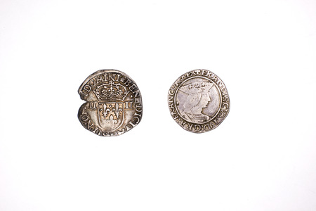 silver coins: Old silver coins with portraits of kings on a white background