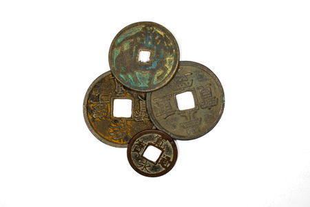 chine: A lot antique bronze Chinese coins on a white background Stock Photo