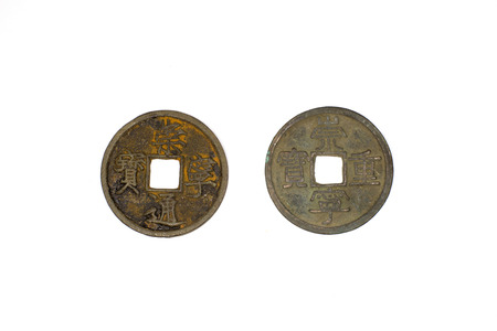 antique coins: A lot antique bronze Chinese coins on a white background Stock Photo
