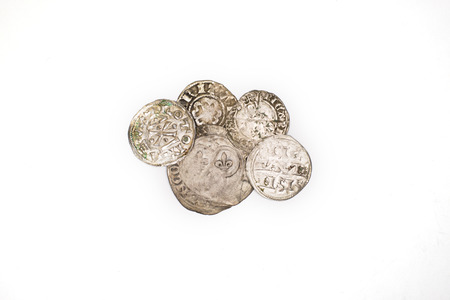gelt: A lot of old silver coins  on a white background