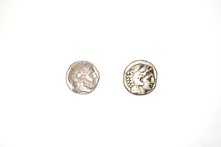 antique coins: Silver antique coins of Alexander the Great and Philip II on a white background.