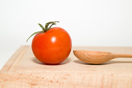 foetus: Ripe red tomatoes on a white background