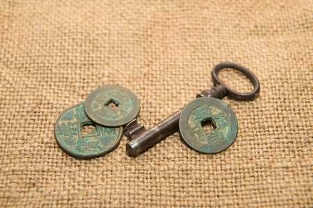 antique coins: Antique bronze coins and keys on old cloth