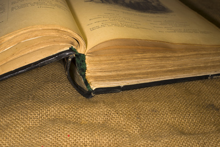 sacking: On sacking is a very old open book Stock Photo