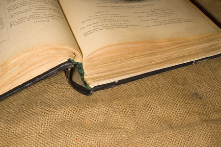 sacking: On the old sacking is a very old open book Stock Photo