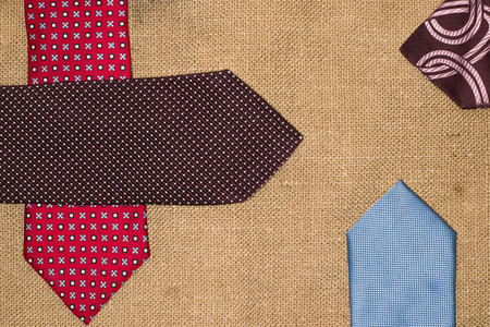 neckcloth: Four beautiful colored ties on the old sacking