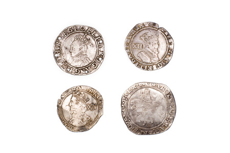 shilling: A lot of old silver coins with portraits of kings on a white background Stock Photo