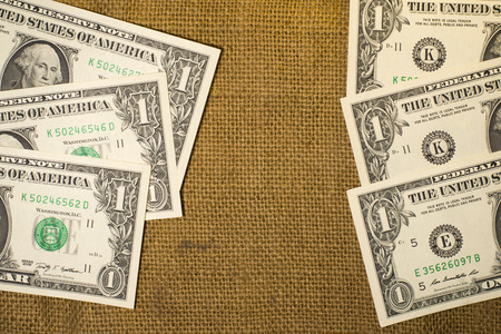 reckon: Banknotes  $1 US  dollars on the very old sacking Stock Photo