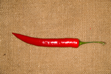 admixture: One red Chile pepper  on old cloth