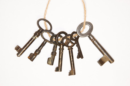 uncover: Some vintage keys from the locks on a white background