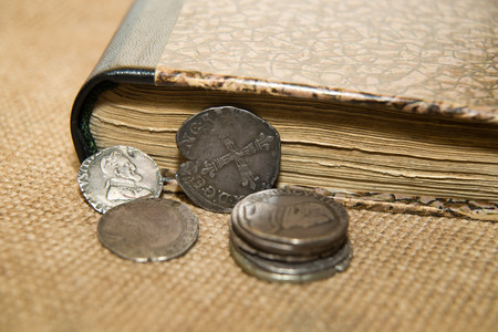 numismatics: A lot of old French silver coins with portraits of kings on the old cloth Stock Photo