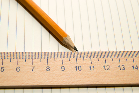 calibre: Notepad with a recording sheet, pencil and wooden ruler on the old tissue Stock Photo