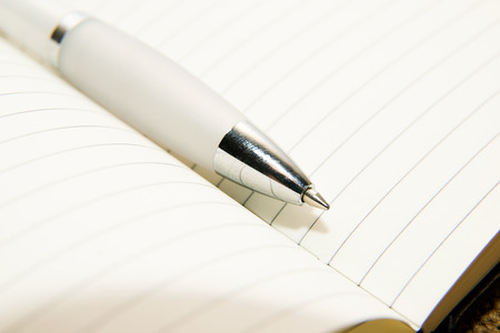 scratchpad: notebook with a blank sheet and pen on the old tissue Stock Photo