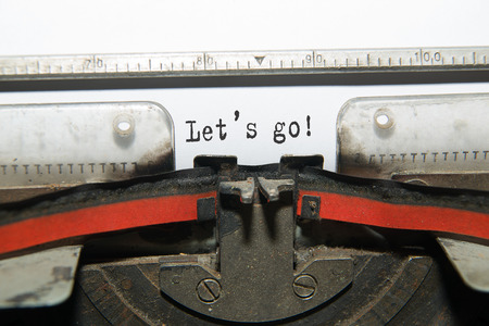 acknowledgment: Sheet of paper with the inscription  Lets go!  in the typewriter Stock Photo