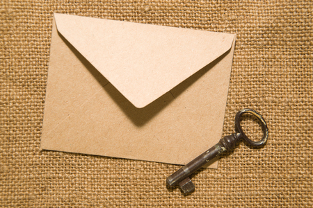 fountainhead: Vintage key and envelope for letters on the old cloth