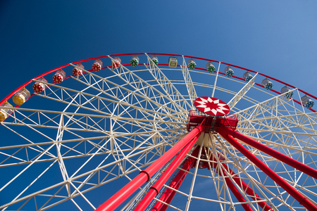 mirth: Atraktsion Ferris wheel against a blue sky with clouds