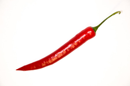 admixture: One red Chile pepper and key ona white background