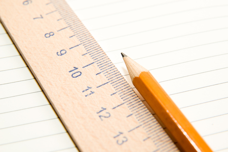 scratchpad: Notepad with a recording sheet, pencil and wooden ruler on the old tissue Stock Photo