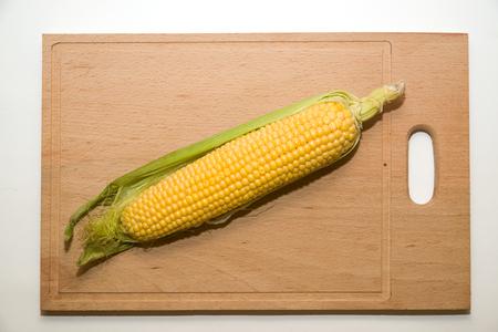emporium: A ripe fruit of corn on over white