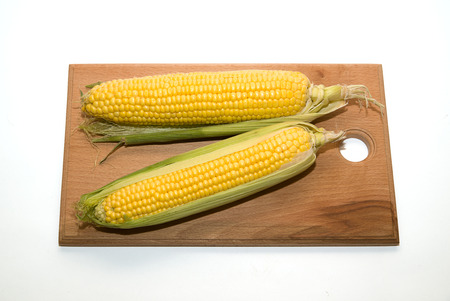 provision: A few mature ears of corn on over white