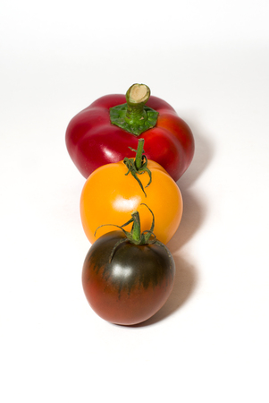 fare: Two tomatoes and peppers on a white background