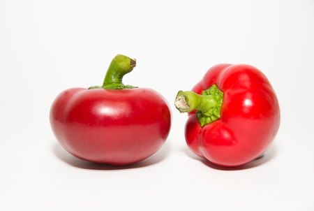 garden stuff: Two red  peppers on a white background