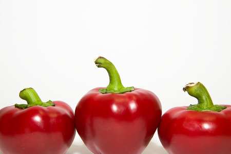 soundness: Three red  peppers on a white background Stock Photo