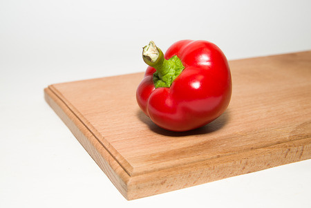 garden stuff: One red  pepper on a white background