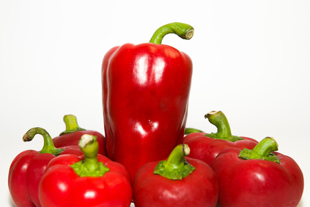 heartiness: Many red  peppers on a white background