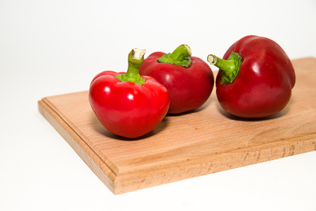 heartiness: Three red  peppers on a white background Stock Photo